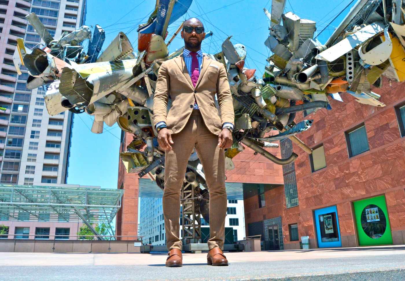 Suit- Club Monaco Shirt- Spread Collar- J-Crew Tie- Paul Smith Tie Bar- The Tie Bar Pocket Square- Polka Dot By J-Crew Shoes- Double Monk Strap- Hugo Boss Glasses- Rayban Wayfarer Nancy Rubin's Chas' Stainless Steel, Mark Thompson's Airplane Parts, About 1000 Pounds of Stainless Steel Wire. (2001)